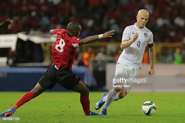Michael Bradley beats Trinidad and Tobago's Khaleem Hyland with an attacking move to his left during a World Cup Qualifier between Trinidad and...