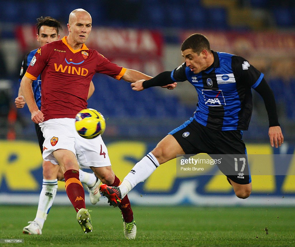 Michael Bradley (L) of AS Roma competes for the ball with Luca Cigarini of Atalanta BC during the TIM Cup match between AS Roma and Atalanta BC at Olimpico Stadium on December 11, 2012 in Rome, Italy.