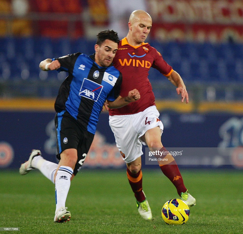 Michael Bradley (R) of AS Roma competes for the ball with Luca Cigarini of Atalanta BC during the TIM Cup match between AS Roma and Atalanta BC at Olimpico Stadium on December 11, 2012 in Rome, Italy.