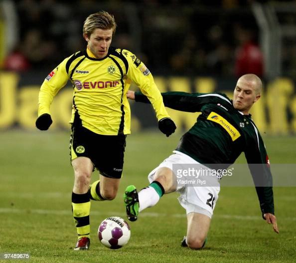 Michael Bradley of Moenchengladbach slides into Jakub Blaszczykowski of Dortmund during the Bundesliga match between Borussia Dortmund and Borussia...