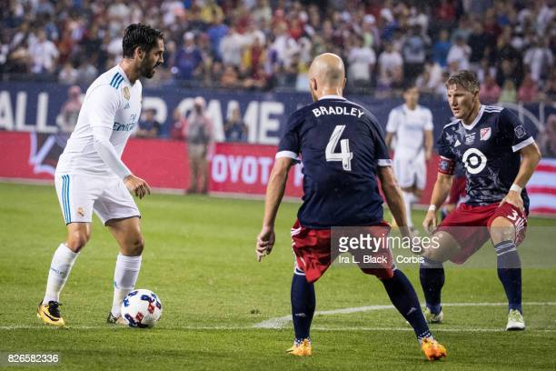 Michael Bradley of the MLS AllStars and Bastian Schweinsteiger of the MLS AllStars try to stop the advance of Isco of Real Madrid during the MLS...