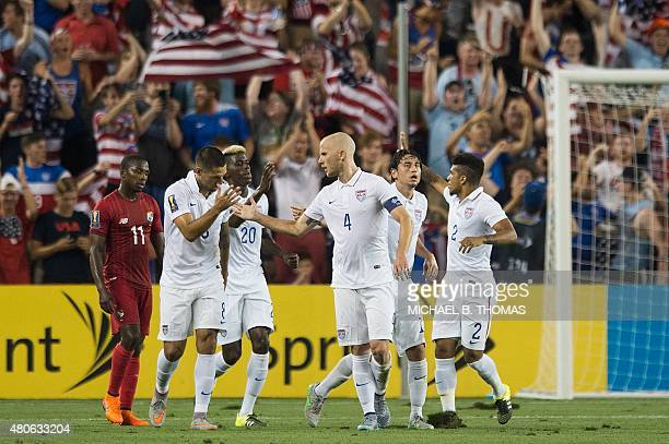 Michael Bradley of the United States celebrates a goal with United States teammates during the CONCACAF Gold Cup match between Panama and United...