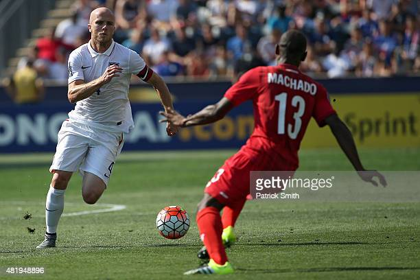 Michael Bradley of the United States dribbles in front of Adolfo Machado of Panama in the first half during the CONCACAF Gold Cup Third Place Match...