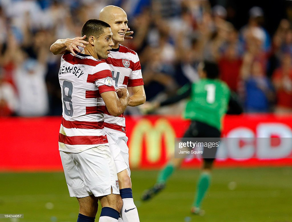 Michael Bradley #4 of the USA congratulates Clint Dempsey #8 after Dempsey scored a goal during the first half fo the World Cup Qualifying match against Guatemala at LiveStrong Sporting Park on October 16, 2012 in Kansas City, Kansas.