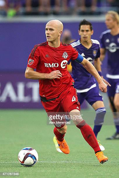 Michael Bradley of Toronto FC dribbles the ball during an MLS soccer match between Toronto FC and the Orlando City SC at the Orlando Citrus Bowl on...
