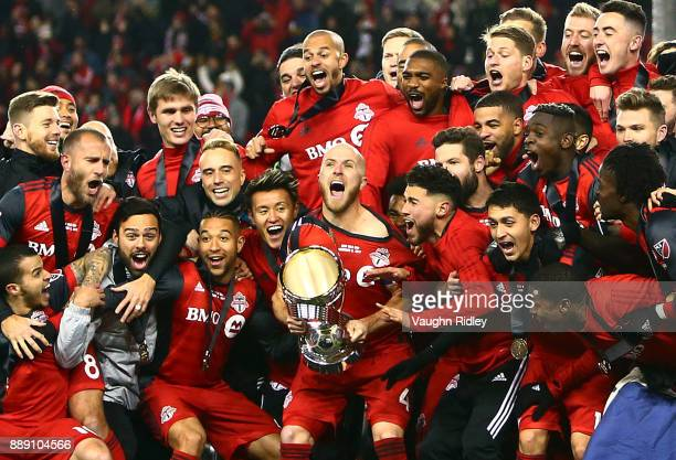 Michael Bradley of Toronto FC lifts the Championship Trophy after winning the 2017 MLS Cup Final against the Seattle Sounders at BMO Field on...