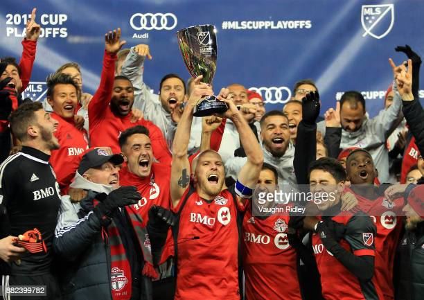 Michael Bradley of Toronto FC lifts the MLS Eastern Conference Finals trophy following victory in the 2nd leg against Columbus Crew SC at BMO Field...