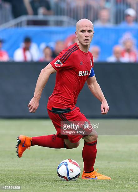 Michael Bradley of Toronto FC looks to pass the ball during an MLS soccer game between the Houston Dynamo and Toronto FC at BMO Field on May 10 2015...