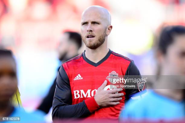 Michael Bradley of Toronto FC sings the United States national anthem before the MLS Soccer regular season game between Toronto FC and Orlando City...