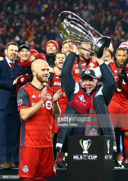 Michael Bradley of Toronto FC watches as owner Larry Tanenbaum lifts the Championship Trophy after winning the 2017 MLS Cup Final against the Seattle...