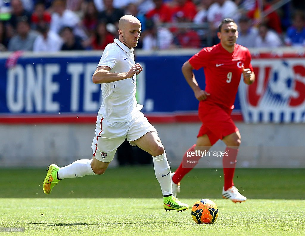 Michael Bradley #4 of United States takes the ball as <a gi-track='captionPersonalityLinkClicked' href=/galleries/search?phrase=Mevlut+Erdinc&family=editorial&specificpeople=5363940 ng-click='$event.stopPropagation()'>Mevlut Erdinc</a> #9 of Turkey defends during an international friendly match at Red Bull Arena on June 1, 2014 in Harrison, New Jersey.The United States defeated Turkey 2-1.