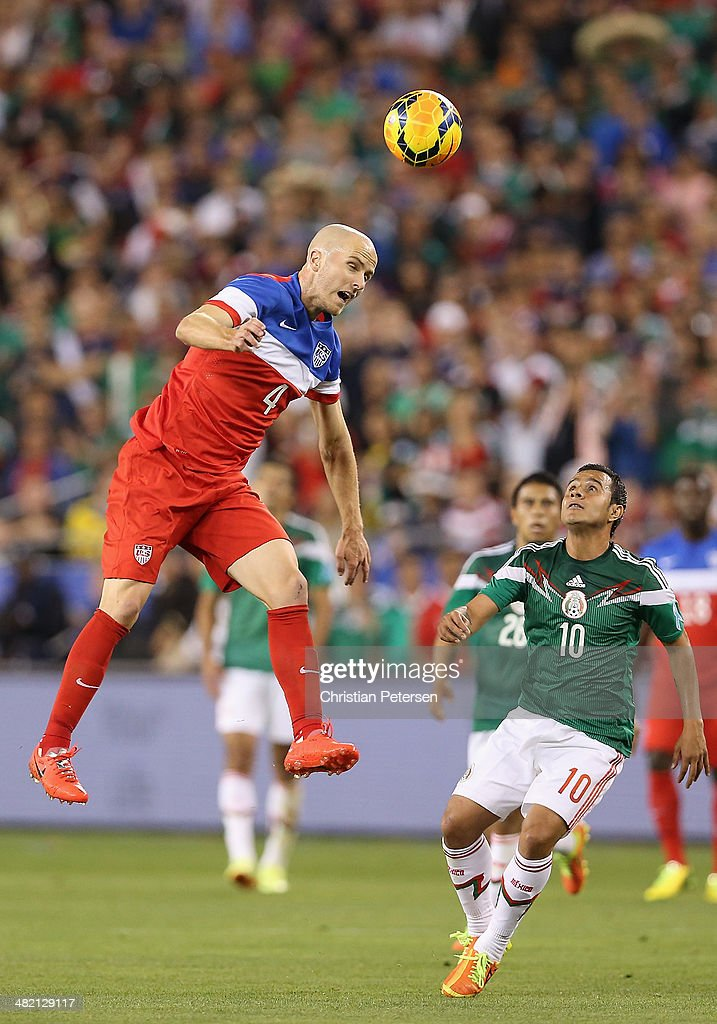 <a gi-track='captionPersonalityLinkClicked' href=/galleries/search?phrase=Michael+Bradley+-+Soccer+Player&family=editorial&specificpeople=7022299 ng-click='$event.stopPropagation()'>Michael Bradley</a> #4 of USA heads the ball past Luis Arturo Montes #10 of Mexico during the first half of the International Friendly at University of Phoenix Stadium on April 2, 2014 in Glendale, Arizona. Mexico and USA played to a 2-2 tie.