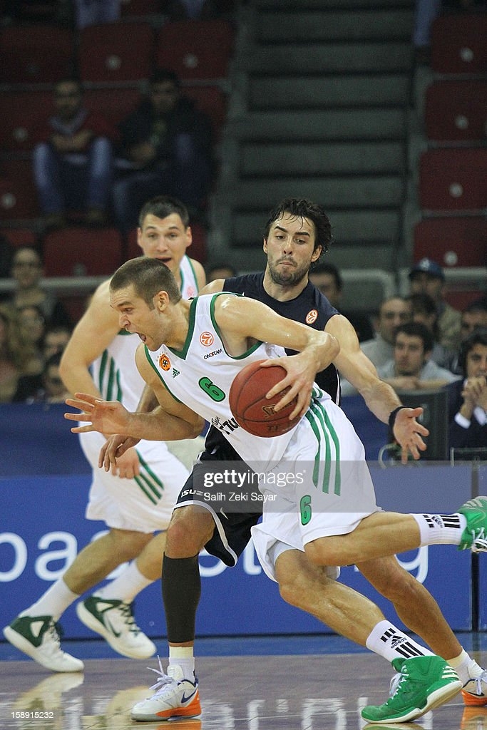 Michael Bramos #6 of Panathinaikos competes with <a gi-track='captionPersonalityLinkClicked' href=/galleries/search?phrase=Sasha+Vujacic&family=editorial&specificpeople=210542 ng-click='$event.stopPropagation()'>Sasha Vujacic</a> #7 of Anadolu Efes during the 2012-2013 Turkish Airlines Euroleague Top 16 Date 2 between Anadolu EFES Istanbul v Panathinaikos Athens at Abdi Ipekci Sports Arena on January 3, 2013 in Istanbul, Turkey.