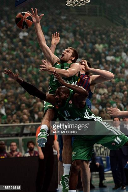 Michael Bramos of Panathinaikos fights for a rebound with Barcelona's Erazem Lorbek during their Euroleague playoff basketball game at the Athens'...