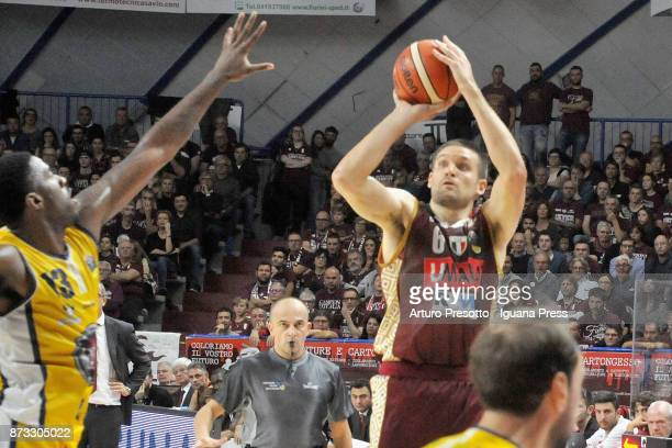 Michael Bramos of Umana competes with Lamar Patterson of Fiat during the LBA LegaBasket of Serie A match between Reyer Umana Venezia and Auxilium...