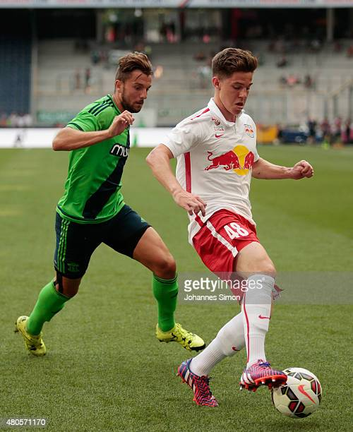 Michael Brandner of Salzburg and Jay Rodriguez of Southampton fight for the ball during the preseason match for the 3rd place between FC Red Bull...