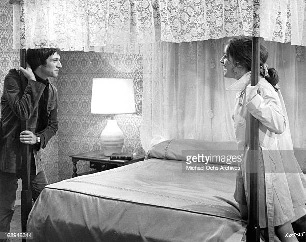 Michael Brandon and Bonnie Bedelia are confronted with their wedding suite in a scene from the film 'Lovers And Other Strangers' 1970