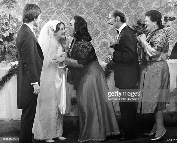 Michael Brandon and Bonnie Bedelia are greeted by their wedding guests in a scene from the film 'Lovers And Other Strangers' 1970