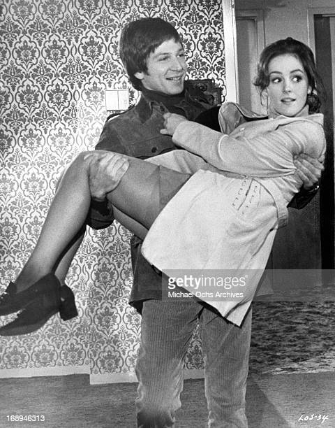 Michael Brandon carries Bonnie Bedelia in a scene from the film 'Lovers And Other Strangers' 1970