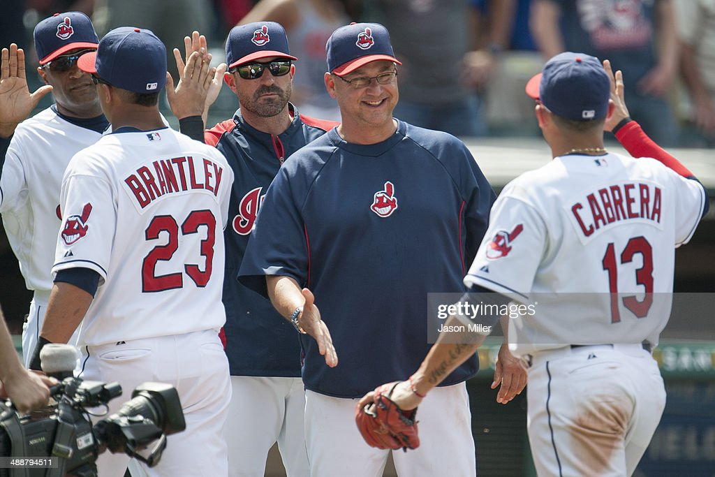 Michael Brantley #23 and <a gi-track='captionPersonalityLinkClicked' href=/galleries/search?phrase=Asdrubal+Cabrera&family=editorial&specificpeople=834042 ng-click='$event.stopPropagation()'>Asdrubal Cabrera</a> #13 of the Cleveland Indians celebrate with pitching coach <a gi-track='captionPersonalityLinkClicked' href=/galleries/search?phrase=Mickey+Callaway&family=editorial&specificpeople=3002338 ng-click='$event.stopPropagation()'>Mickey Callaway</a> #32 and manager <a gi-track='captionPersonalityLinkClicked' href=/galleries/search?phrase=Terry+Francona&family=editorial&specificpeople=171936 ng-click='$event.stopPropagation()'>Terry Francona</a> #17 (2nd R) of the Cleveland Indians after the Indians defeated the Minnesota Twins at Progressive Field on May 8, 2014 in Cleveland, Ohio. The Indians defeated the Twins 9-4.