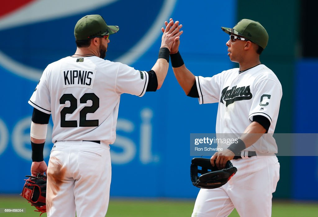 Michael Brantley #23 and Jason Kipnis #22 of the Cleveland Indians celebrate a 10-1 victory over the Kansas City Royals at Progressive Field on May 28, 2017 in Cleveland, Ohio.