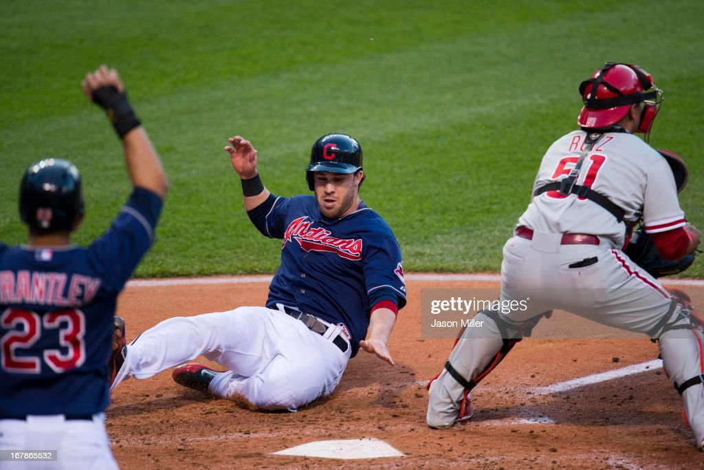 Michael Brantley #23 and <a gi-track='captionPersonalityLinkClicked' href=/galleries/search?phrase=Jason+Kipnis&family=editorial&specificpeople=5330784 ng-click='$event.stopPropagation()'>Jason Kipnis</a> #22 of the Cleveland Indians score during the third inning as catcher Carlos Ruiz #51 of the Philadelphia Phillies waits for the throw at Progressive Field on May 1, 2013 in Cleveland, Ohio.