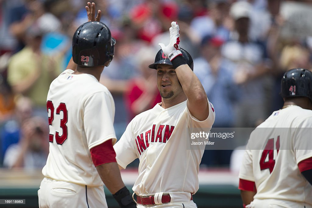 Michael Brantley #23 celebrates with Ryan Raburn #9 of the Cleveland Indians after both scored on a three run home run hit by Raburn during the second inning against the Seattle Mariners at Progressive Field on May 20, 2013 in Cleveland, Ohio.