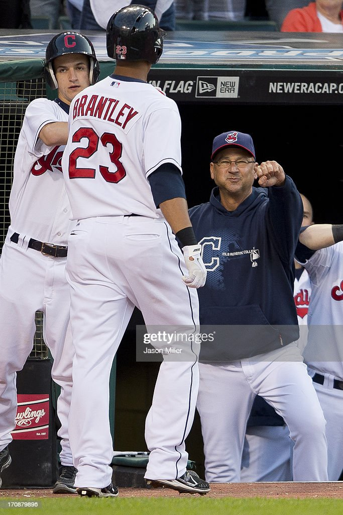 Michael Brantley #23 celebrates with <a gi-track='captionPersonalityLinkClicked' href=/galleries/search?phrase=Terry+Francona&family=editorial&specificpeople=171936 ng-click='$event.stopPropagation()'>Terry Francona</a> #17 of the Cleveland Indians after Brantley hit a solo home run during the fifth inning against the Kansas City Royals at Progressive Field on June 19, 2013 in Cleveland, Ohio.