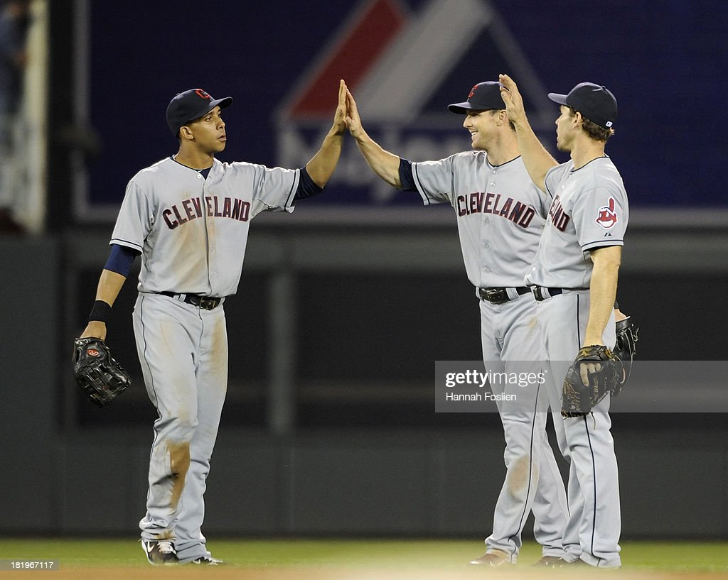 Michael Brantley #23, <a gi-track='captionPersonalityLinkClicked' href=/galleries/search?phrase=Drew+Stubbs+-+Baseball+Player&family=editorial&specificpeople=4498334 ng-click='$event.stopPropagation()'>Drew Stubbs</a> #11 and Matt Carson #7 of the Cleveland Indians celebrate a win of the game against the Minnesota Twins on September 26, 2013 at Target Field in Minneapolis, Minnesota. The Indians defeated the Twins 6-5.
