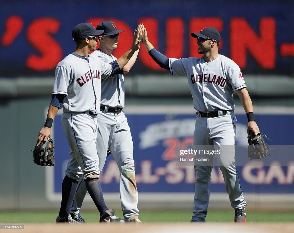 Michael Brantley #23, <a gi-track='captionPersonalityLinkClicked' href=/galleries/search?phrase=Drew+Stubbs+-+Jugador+de+b%C3%A9isbol&family=editorial&specificpeople=4498334 ng-click='$event.stopPropagation()'>Drew Stubbs</a> #11 and <a gi-track='captionPersonalityLinkClicked' href=/galleries/search?phrase=Ryan+Raburn&family=editorial&specificpeople=2541483 ng-click='$event.stopPropagation()'>Ryan Raburn</a> #9 of the Cleveland Indians celebrate a win of the game against the Minnesota Twins on July 21, 2013 at Target Field in Minneapolis, Minnesota. The Indians defeated the Twins 7-1.