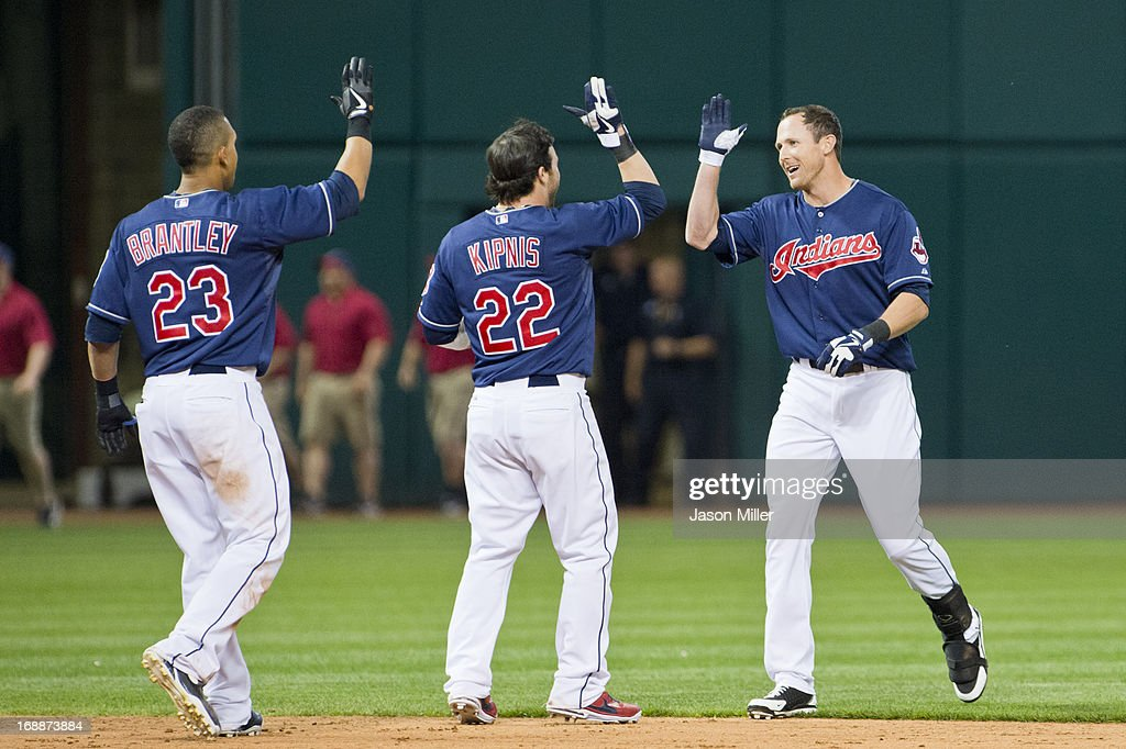 Michael Brantley #23, <a gi-track='captionPersonalityLinkClicked' href=/galleries/search?phrase=Jason+Kipnis&family=editorial&specificpeople=5330784 ng-click='$event.stopPropagation()'>Jason Kipnis</a> #22, and <a gi-track='captionPersonalityLinkClicked' href=/galleries/search?phrase=Drew+Stubbs+-+Baseball+Player&family=editorial&specificpeople=4498334 ng-click='$event.stopPropagation()'>Drew Stubbs</a> #11 of the Cleveland Indians celebrate after their victory against the Minnesota Twins at Progressive Field on May 3, 2013 in Cleveland, Ohio. The Indians defeated the Twins 7-6.