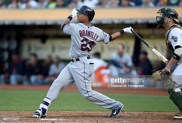 Michael Brantley of the Cleveland Indians bats against the Oakland Athletics in the top of the fourth inning at Oco Coliseum on August 1 2015 in...