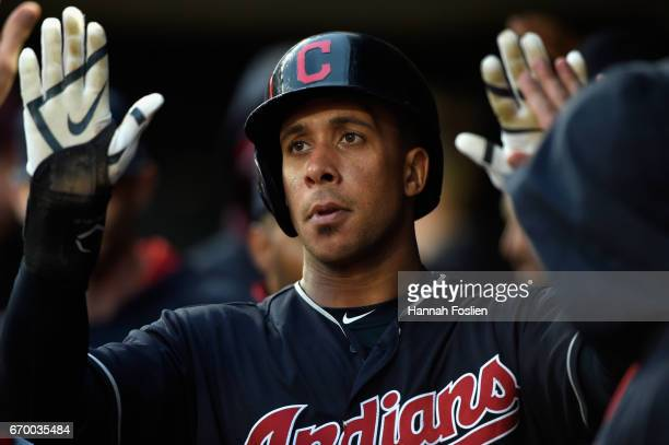 Michael Brantley of the Cleveland Indians celebrates scoring against the Minnesota Twins during the first inning of the game on April 18 2017 at...
