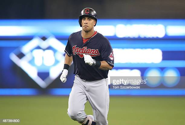 Michael Brantley of the Cleveland Indians circles the bases after hitting a solo home run in the fourth inning during MLB game action against the...