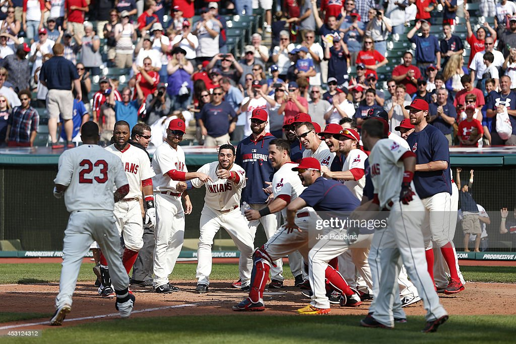 Michael Brantley #23 of the Cleveland Indians heads for home plate to celebrate with teammates after hitting a home run to win the game in the 12th inning against the Texas Rangers at Progressive Field on August 3, 2014 in Cleveland, Ohio. The Indians won 4-3.