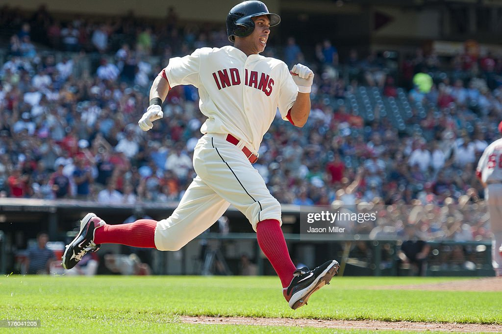 Michael Brantley #23 of the Cleveland Indians hits a double to deep right during the eighth inning against the Los Angeles Angels of Anaheim at Progressive Field on August 11, 2013 in Cleveland, Ohio. The Indians defeated the Angels 6-5.
