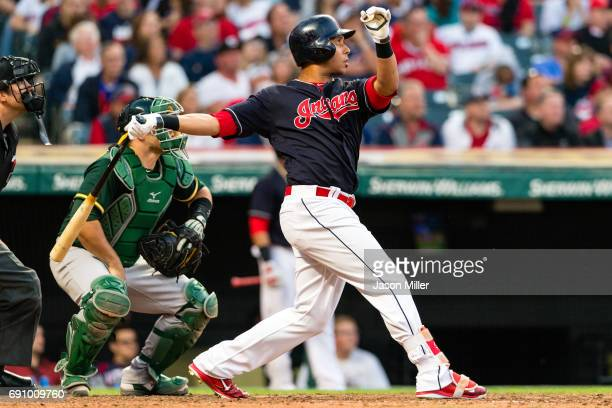 Michael Brantley of the Cleveland Indians hits a fly ball to left field reaching second on an error during the ninth inning against the Oakland...