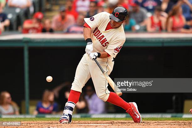 Michael Brantley of the Cleveland Indians hits a leadoff double in the fifth inning against the Cincinnati Reds at Progressive Field on May 24 2015...