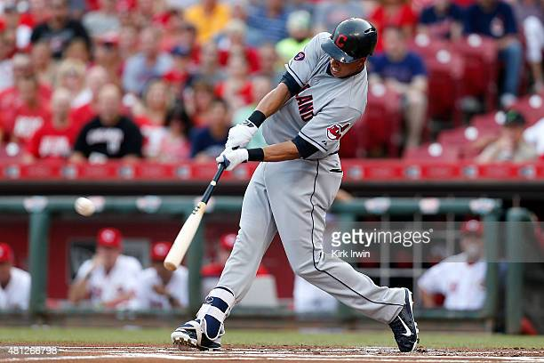Michael Brantley of the Cleveland Indians hits a three run home run off of Anthony DeSclafani of the Cincinnati Reds during the first inning at Great...