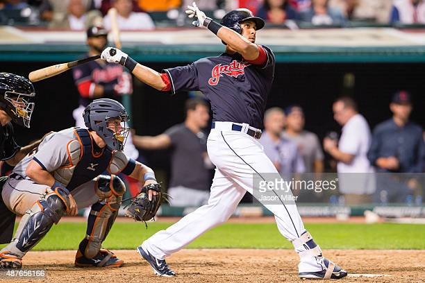 Michael Brantley of the Cleveland Indians hits a two run home run during the eighth inning against the Detroit Tigers at Progressive Field on...