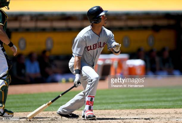 Michael Brantley of the Cleveland Indians hits a tworun rbi single against the Oakland Athletics in the top of the fourth inning at Oakland Alameda...