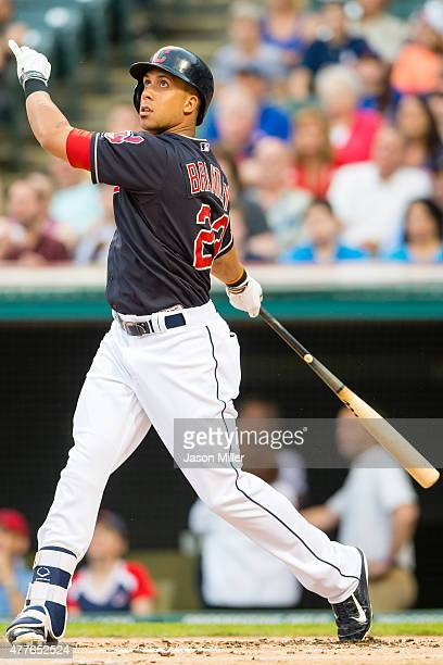 Michael Brantley of the Cleveland Indians hits an RBI ground rule double to left during the first inning against the Chicago Cubs at Progressive...