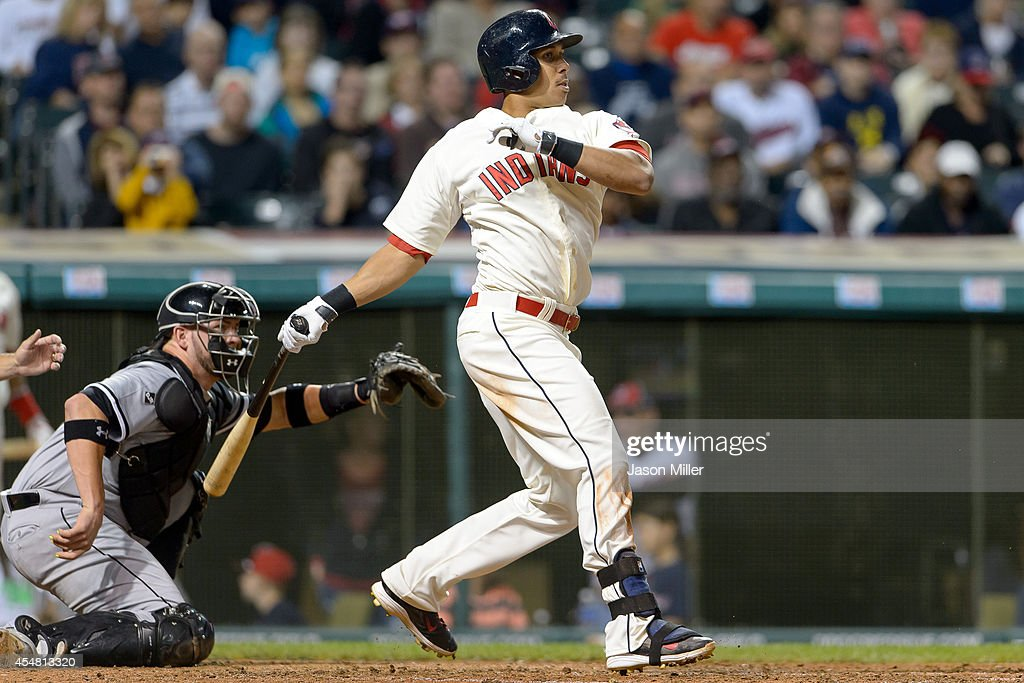 Michael Brantley #23 of the Cleveland Indians hits an RBI single during the seventh inning against the Chicago White Sox at Progressive Field on September 6, 2014 in Cleveland, Ohio.