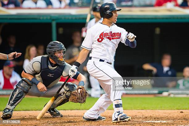 Michael Brantley of the Cleveland Indians hits an RBI single during the third inning against the Detroit Tigers at Progressive Field on June 22 2015...
