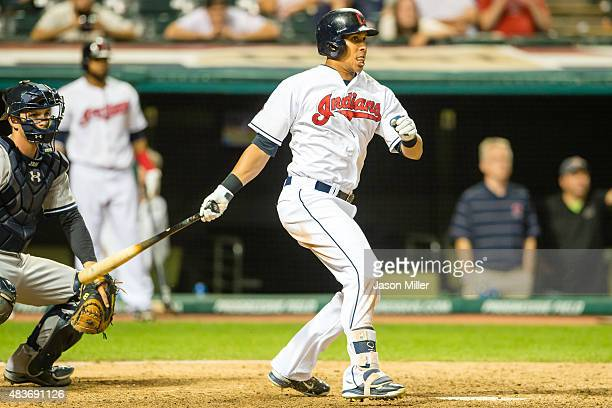 Michael Brantley of the Cleveland Indians hits an RBI single scoring Jose Ramirez to win the game in the 16th inning against the New York Yankees at...