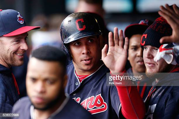 Michael Brantley of the Cleveland Indians is congratulated by his teammates after stealing home on a wild pitch during the fourth inning of the game...