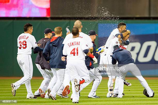 Michael Brantley of the Cleveland Indians is mobbed by his teammates after hitting a walkoff single during the 16th inning against the New York...
