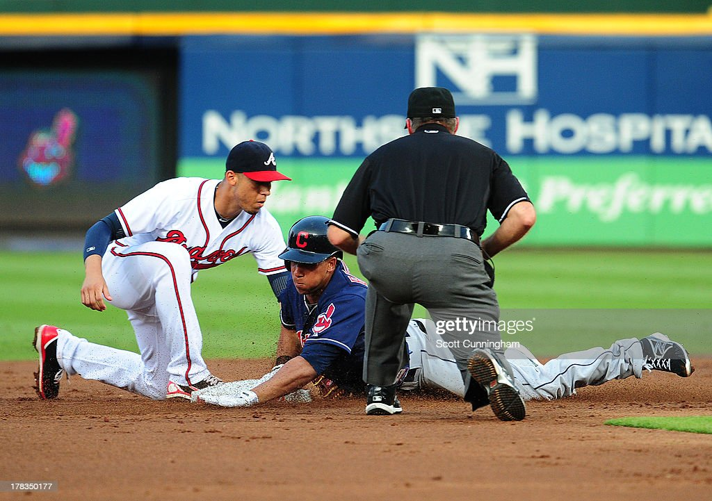 Michael Brantley #23 of the Cleveland Indians is tagged out at second base by <a gi-track='captionPersonalityLinkClicked' href=/galleries/search?phrase=Andrelton+Simmons&family=editorial&specificpeople=8978424 ng-click='$event.stopPropagation()'>Andrelton Simmons</a> #19 of the Atlanta Braves at Turner Field on August 29, 2013 in Atlanta, Georgia.