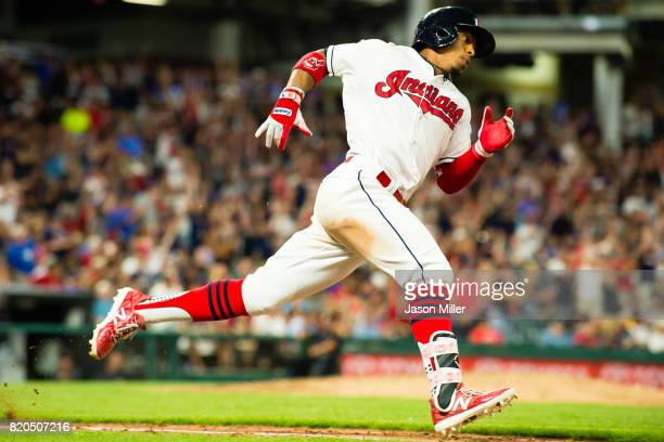 Michael Brantley of the Cleveland Indians rounds first on an RBI double during the seventh inning against the Toronto Blue Jays at Progressive Field...