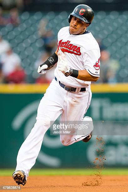 Michael Brantley of the Cleveland Indians rounds second on his way home off a double by David Murphy during the first inning against the Houston...